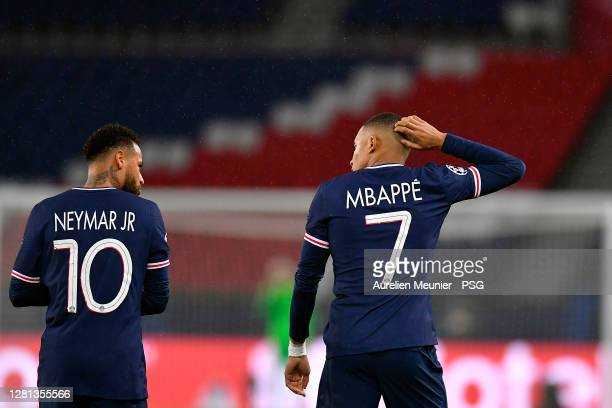 Neymar Jr of Paris SaintGermain is congratulated by teammate Kylian Mbappe after an own goal of Anthony Martial of Manchester United following his...