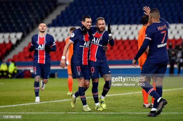 Neymar Jr of Paris Saint-Germain is congratulated by teammates Angel Di Maria and Kylian Mbappe after scoring during the Ligue 1 match between Paris...