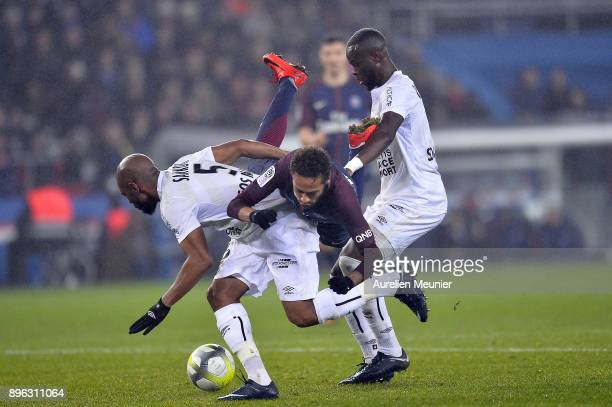 Neymar Jr of Paris SaintGermain is tackled by Baissama Sankoh of SM Saen during the Ligue 1 match between Paris Saint Germain and SM Caen at Parc des...