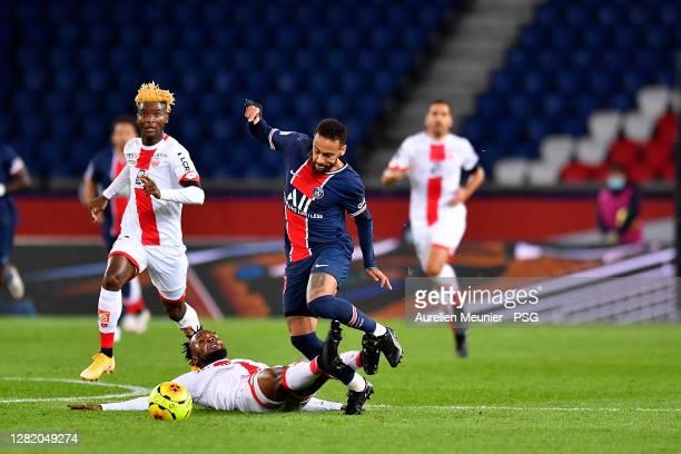 Neymar Jr of Paris SaintGermain is tackled during the Ligue 1 match between Paris SaintGermain and Dijon FCO at Parc des Princes on October 24 2020...
