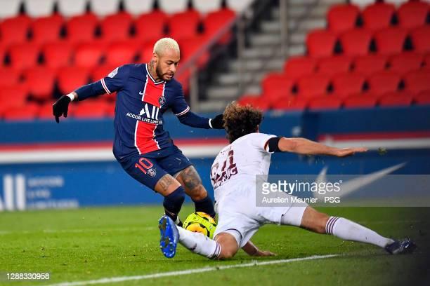 Neymar Jr of Paris Saint-Germain is tackled during the Ligue 1 match between Paris Saint-Germain and Girondins Bordeaux at Parc des Princes on...