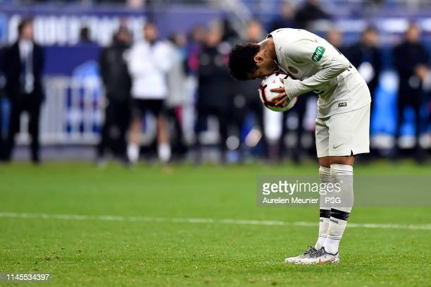 Neymar Jr of Paris Saint-Germain kisses the ball before his penalty during the penalty session during the French Cup Final match between Paris...