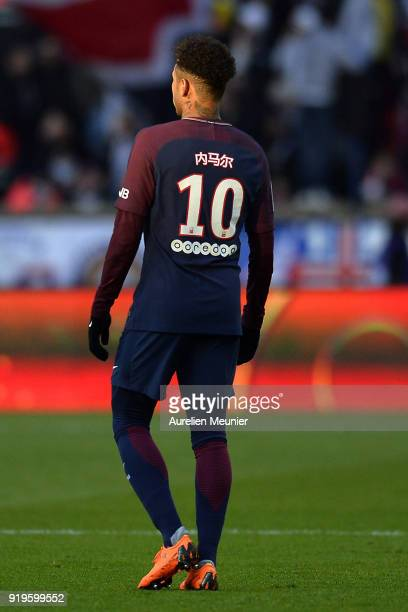 Neymar Jr of Paris SaintGermain looks on as his name written in Chinese is displayed on his shirt as a tribute to the Chinese New Year during the...