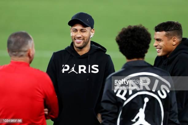 Neymar Jr of Paris SaintGermain looks on as Paris SaintGermain walks the pitch on the eve of their UEFA Champions League Match against Liverpool at...