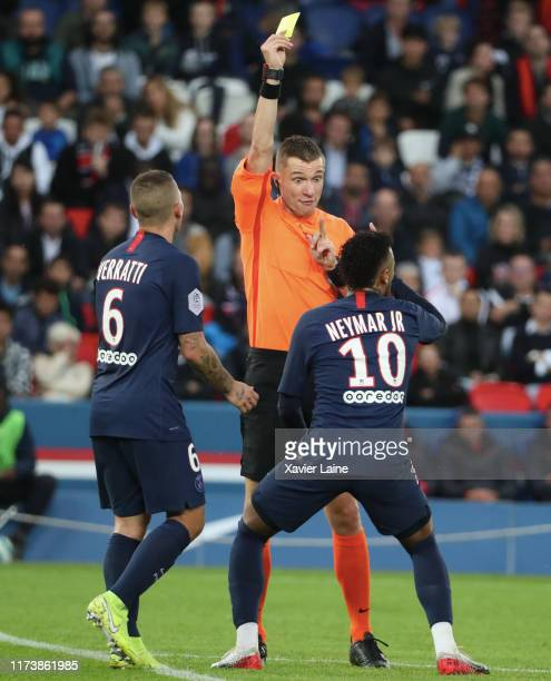 Neymar Jr of Paris SaintGermain react after reveive a yellow card by referee Willy Delajod during the Ligue 1 match between Paris SaintGermain and...
