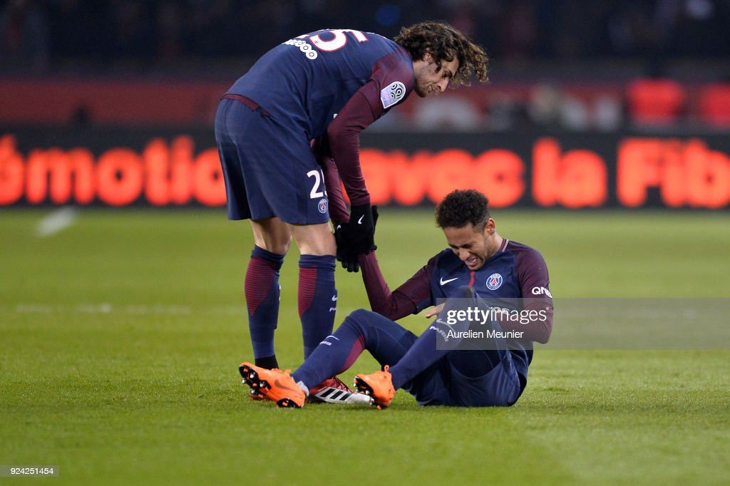 Neymar Jr of Paris Saint-Germain reacts after being tackled during the Ligue 1 match between Paris Saint Germain and Olympique Marseille February 25, 2018 in Paris, France.
