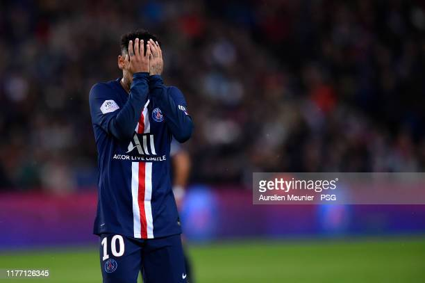 Neymar Jr of Paris Saint-Germain reacts after missing a free kick during the Ligue 1 match between Paris Saint-Germain and Stade Reims at Parc des...