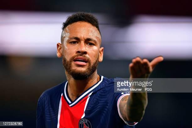 Neymar Jr of Paris Saint-Germain reacts as he confronts with Alvaro of Olympique de Marseille during the Ligue 1 match between Paris Saint-Germain...