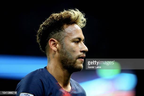 Neymar Jr of Paris Saint-Germain reacts during the French Ligue 1 match between Paris Saint Germain and Stade Reims on September 26, 2018 in Paris,...