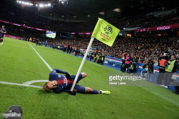 Neymar Jr of Paris SaintGermain rolls in pain and hangs in the corner flag during the French Ligue 1 match between ParisSaint Germain and Lille OSC...