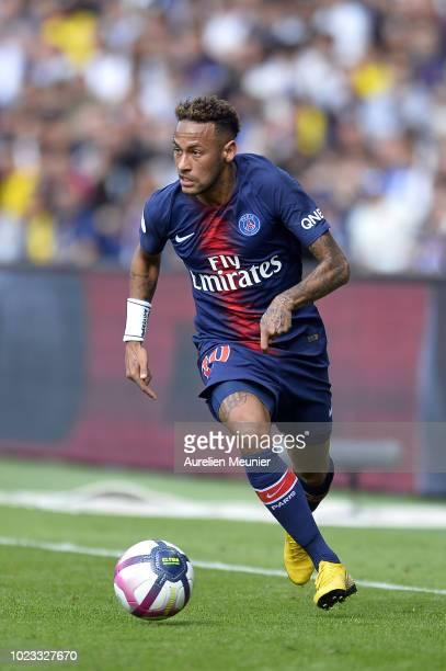 Neymar Jr of Paris SaintGermain runs with the ball during the Ligue 1 match between Paris SaintGermain and Angers SCO at Parc des Princes on August...