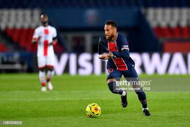 Neymar Jr of Paris SaintGermain runs with the ball during the Ligue 1 match between Paris SaintGermain and Dijon FCO at Parc des Princes on October...