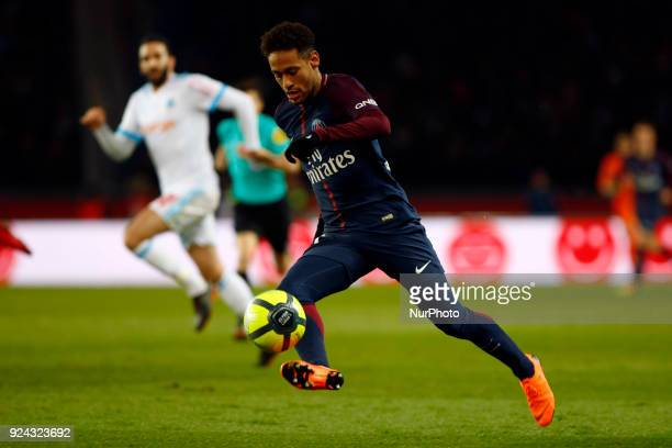 Neymar Jr of Paris SaintGermain runs with the ball during the Ligue 1 match between Paris Saint Germain and Olympique Marseille February 25 2018 in...