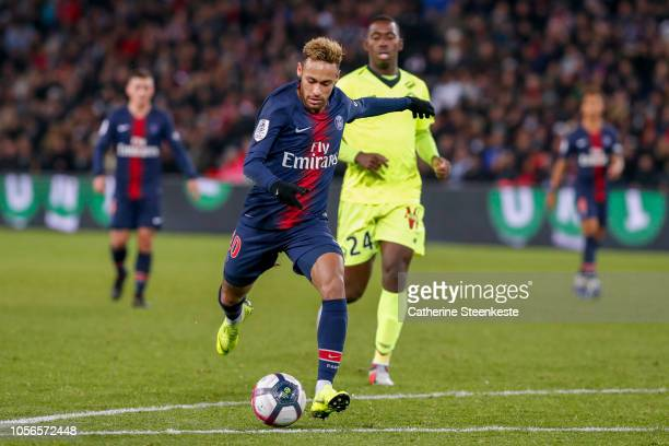 Neymar Jr of Paris SaintGermain shoots the ball to score the second goal of the game against Boubakary Soumare of Losc during the Ligue 1 game...