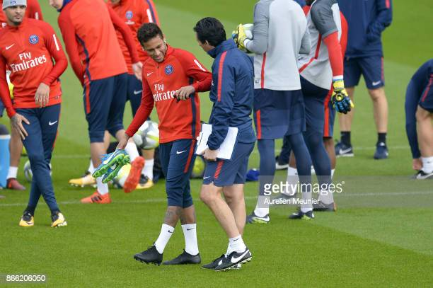 Neymar Jr of Paris SaintGermain speaks with his Head Coach Unai Emery as he arrives for a Paris SaintGermain practice session at Centre Ooredoo on...