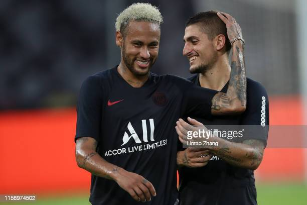 Neymar Jr of Paris SaintGermain talk with Leandro Paredes during the training session ahead of the French Trophy of Champions football match between...
