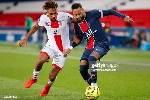 Neymar Jr of Paris SaintGermain tries to control the ball against Sacha Boey of Dijon FCO during the Ligue 1 match between Paris SaintGermain and...