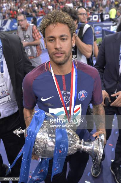Neymar Jr of Paris SaintGermain walks to the fans with the Trophy after the victory over Les Herbiers VF during the Coupe de France Final between Les...