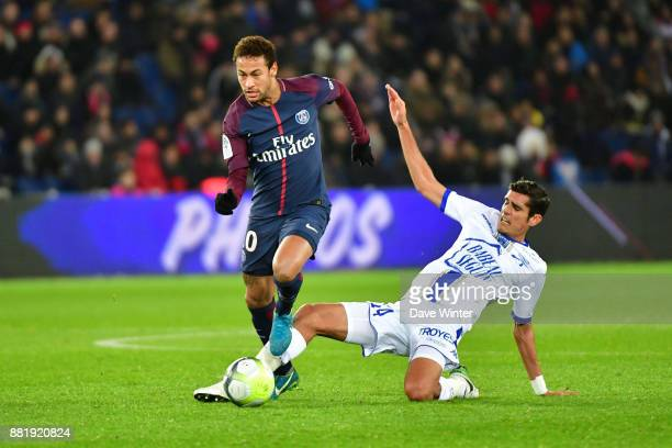 Neymar Jr of PSG and Francois Bellugou of Troyes during the Ligue 1 match between Paris Saint Germain and Troyes Estac at Parc des Princes on...