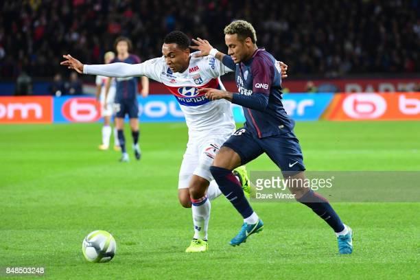 Neymar JR of PSG and Kenny Tete of Lyon during the Ligue 1 match between Paris Saint Germain and Olympique Lyonnais at Parc des Princes on September...