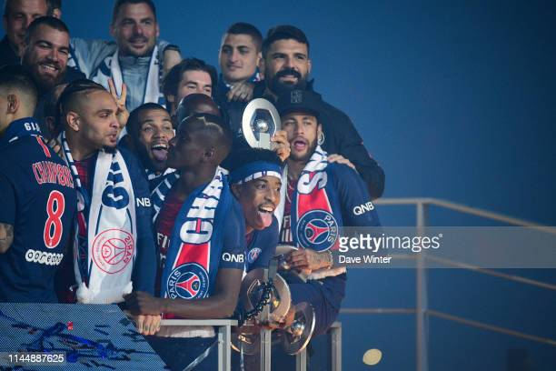 Neymar JR of PSG and Presnel Kimpembe of PSG celebrate winning the league championship following the Ligue 1 match between Paris Saint Germain and...