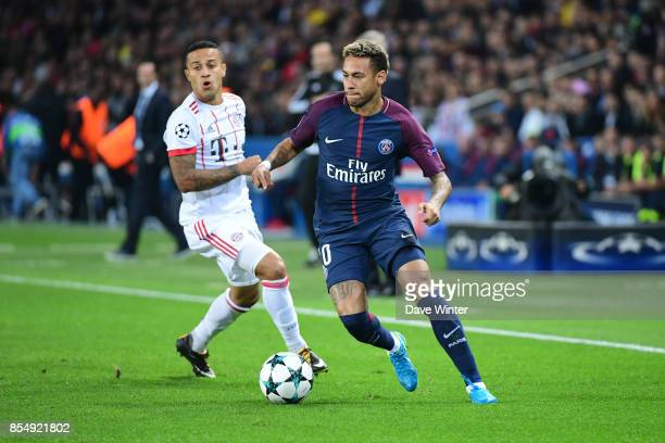 Neymar JR of PSG and Thiago of Bayern Munich during the Uefa Champions League match between Paris Saint Germain and FC Bayern Munich on September 27,...