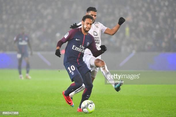 Neymar JR of PSG and Youssef Ait Bennasser of Caen during the Ligue 1 match between Paris Saint Germain and SM Caen at Parc des Princes on December...