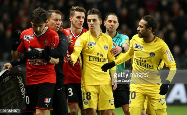 Neymar Jr of PSG argues with Sanjin Prcic of Stade Rennais while assistant referee Adrien Hunou of Stade Rennais Giovani Lo Celso of PSG referee...