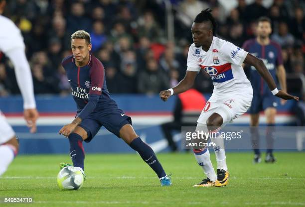 Neymar Jr of PSG Bertrand Traore of Lyon during the French Ligue 1 match between Paris Saint Germain and Olympique Lyonnais at Parc des Princes on...
