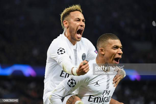Neymar Jr of PSG celebrates a goal with Kylian Mbappe during the UEFA Champions League Group C match between Paris Saint Germain and Liverpool on...