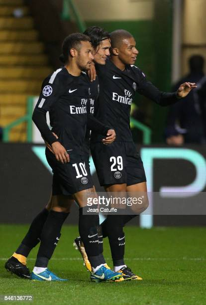 Neymar Jr of PSG celebrates his goal with Edinson Cavani and Kylian Mbappe during the UEFA Champions League match between Celtic Glasgow and Paris...