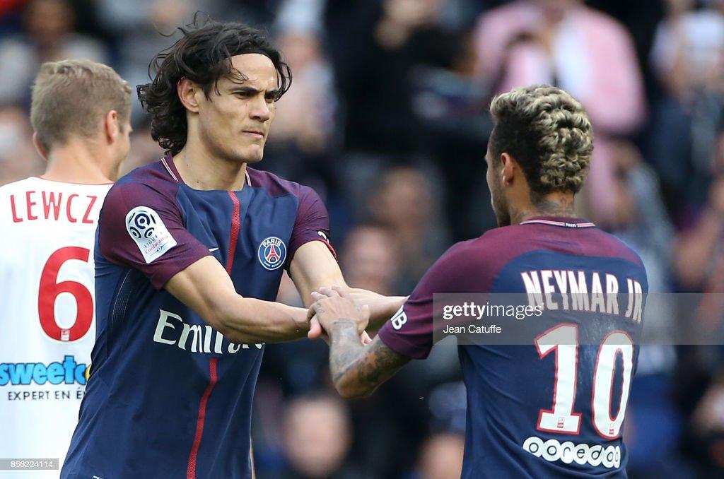 Neymar Jr of PSG celebrates his second goal with Edinson Cavani (left) during the French Ligue 1 match between Paris Saint-Germain (PSG) and FC Girondins de Bordeaux at Parc des Princes on September 30, 2017 in Paris, France.