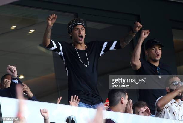 Neymar Jr of PSG celebrates the goal of Edinson Cavani during the French Ligue 1 match between Paris Saint Germain and Amiens SC at Parc des Princes...