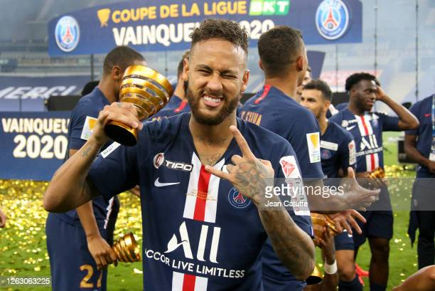 Neymar Jr of PSG celebrates the victory during the trophy ceremony following the French League Cup final between Paris Saint-Germain and Olympique...
