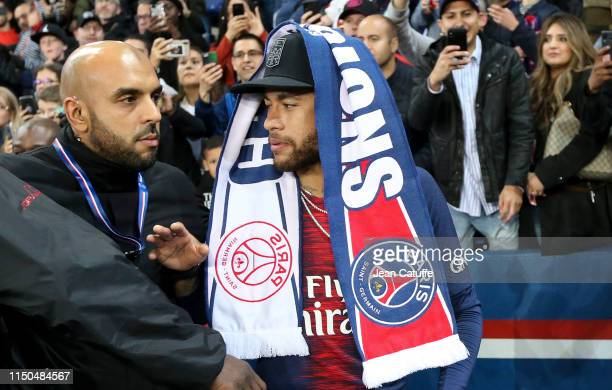 Neymar Jr of PSG celebrates winning the 'French Championship 2018-2019' during the trophy ceremony following the French Ligue 1 match between Paris...