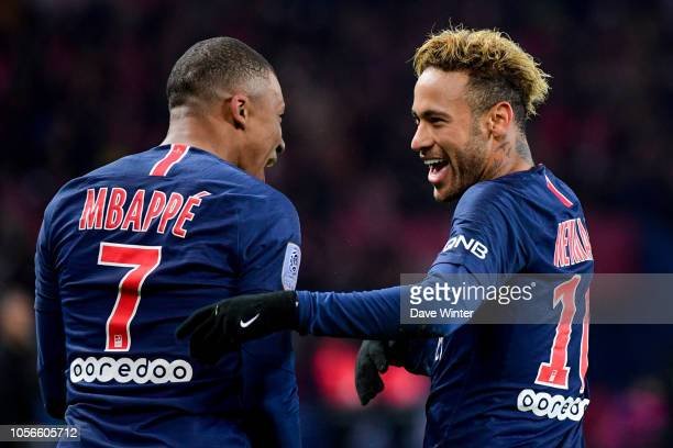Neymar JR of PSG celebrates with Kylian Mbappe of PSG after putting their side side 20 ahead during the Ligue 1 match between Paris Saint Germain and...