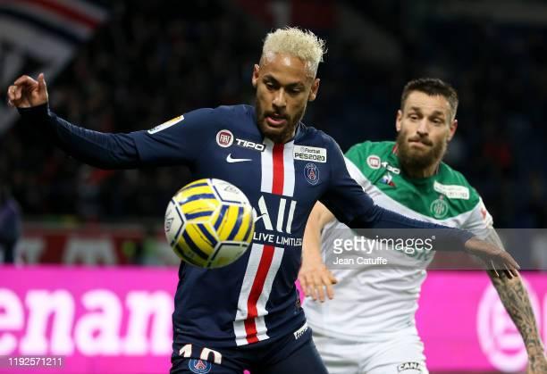 Neymar Jr of PSG controls the bal agianst Mathieu Debuchy of Saint-Etienne during the French League Cup quarter final between Paris Saint-Germain and...