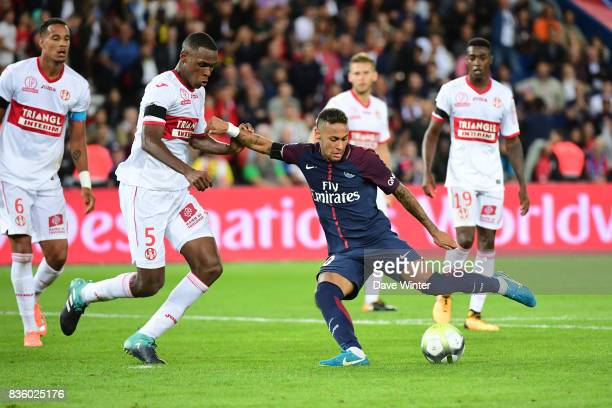 Neymar JR of PSG dribbles through the Toulouse defence before shooting to make the score 62 during the Ligue 1 match between Paris Saint Germain and...