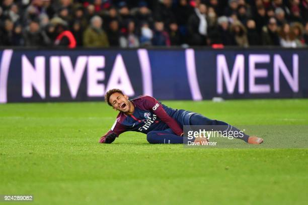 Neymar JR of PSG goes down injured during the Ligue 1 match between Paris Saint Germain and Olympique Marseille at Parc des Princes on February 25...