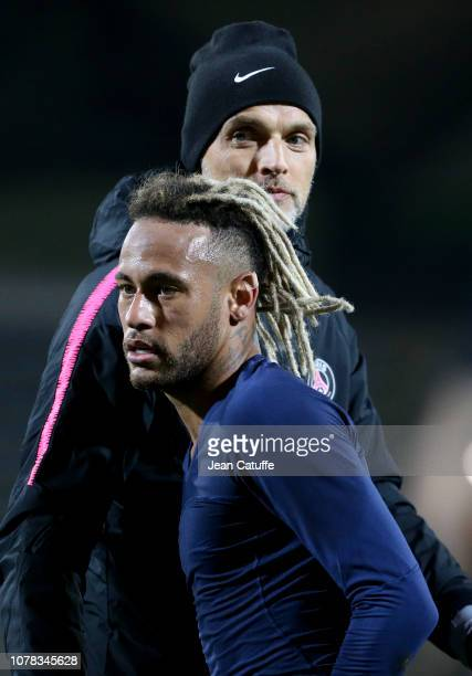 Neymar Jr of PSG hugs coach of PSG Thomas Tuchel following the French Cup match between GSI Pontivy and Paris Saint Germain at Stade du Moustoir on...