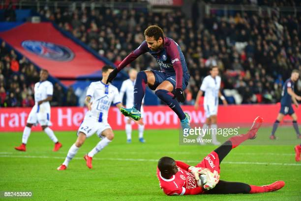 Neymar JR of PSG hurdles Mamadou Samassa of Troyes during the Ligue 1 match between Paris Saint Germain and Troyes Estac at Parc des Princes on...