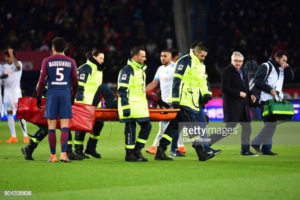 Neymar JR of PSG is carried off injured on a stretcher during the Ligue 1 match between Paris Saint Germain and Olympique Marseille at Parc des...