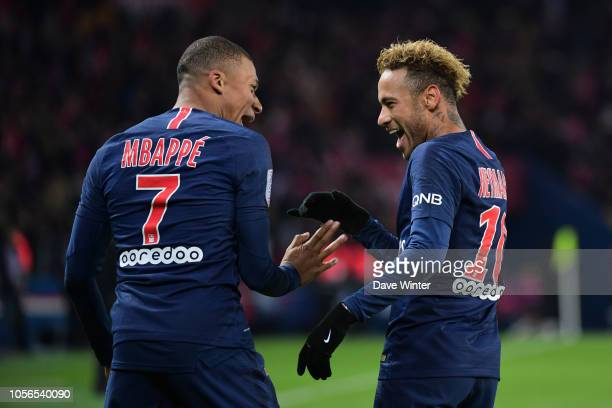 Neymar JR of PSG is congratulated by Kylian Mbappe of PSG after putting their side 20 ahead during the Ligue 1 match between Paris Saint Germain and...