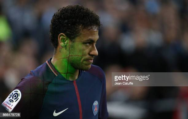 Neymar Jr of PSG is the target of a green laser during the French Ligue 1 match between Olympique de Marseille and Paris Saint Germain at Stade...