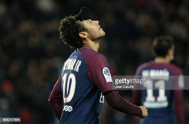 Neymar Jr of PSG juggles with his glove on his head to celebrate his first goal during the French Ligue 1 match between Paris Saint Germain and Dijon...