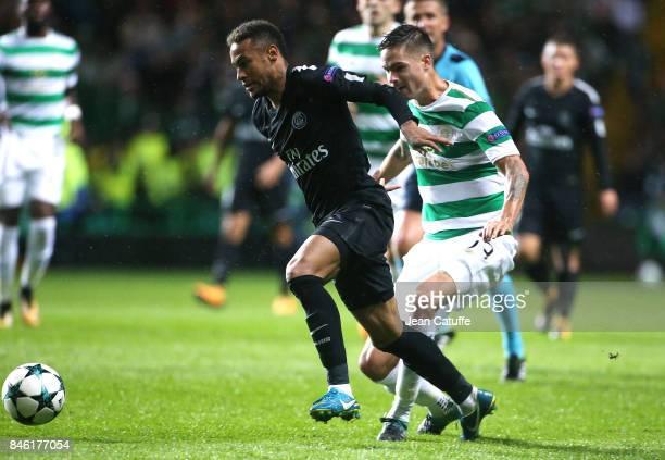 Neymar Jr of PSG Mikael Lustig of Celtic Glasgow during the UEFA Champions League match between Celtic Glasgow and Paris Saint Germain at Celtic Park...