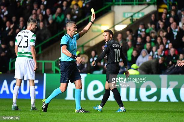 Neymar JR of PSG receives a yellow card from referee Daniele Orsato during the Uefa Champions League match between Glasgow Celtic and Paris Saint...