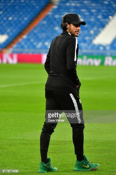 Neymar JR of PSG strolls on the pitch during the Paris Saint Germain press conference ahead of the Champions League match against Real Madrid on...