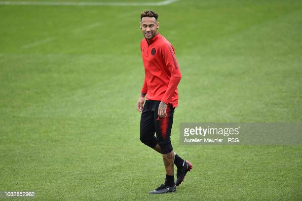 Neymar Jr reacts during a Paris SaintGermain training session at Centre Ooredoo on September 13 2018 in Paris France