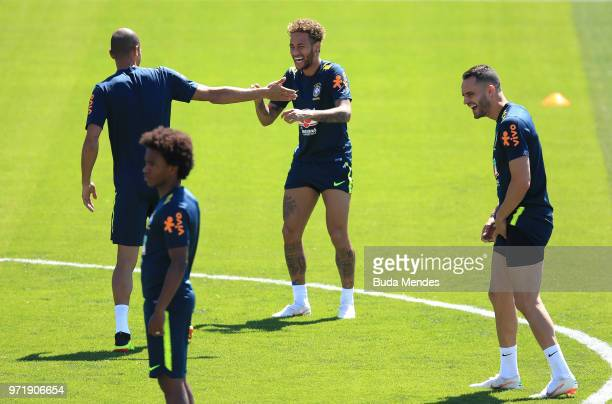 Neymar Jr Renato Augusto and Willian of Brazil take part during a Brazil training session ahead of the FIFA World Cup 2018 in Russia at YugSport...